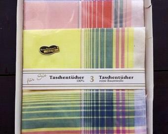 Set of three unused handkerchiefs