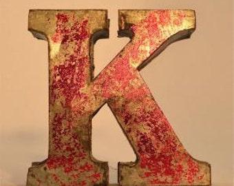 A fantastic vintage style metal 3D red letter K