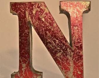 A fantastic vintage style metal 3D red letter N