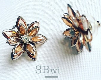 Stud earrings made from apricot/champagne colored Swarovski components