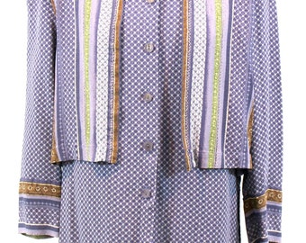 Beautiful purple blouse with array of different designs and colors/ front flaps on either side of center and side openings . By Donavan