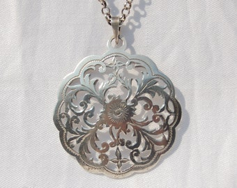 Fine Vintage Large Silver Pendant with long chain.