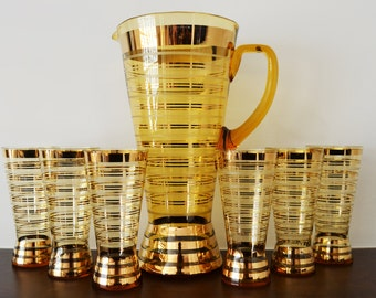 Mid Century Modern Gold Barware Set - Pitcher and 6 glasses - Gold Stripes and Amber Glass, circa 1960s