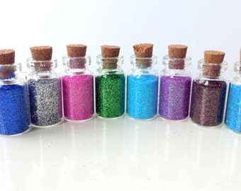 8 lovely little bottles filled with 8 different colors of powder glitters