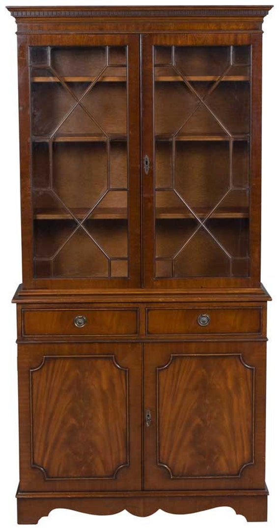 mahogany two door glass top bookcase with drawers and doors