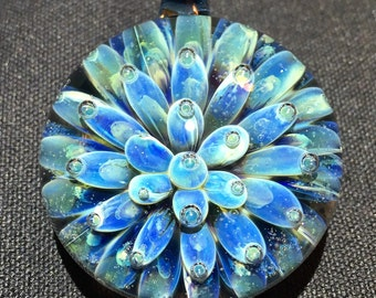 """1-1/4"""" Borosilicate Air Trap Implosion Pendant in Europa with Raindrop Background."""