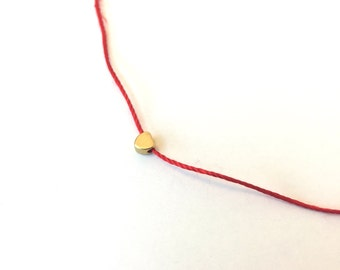 red silk cord choker necklace with tiny gold heart charm