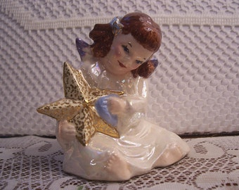 Angel  Holding a Gold Star Figurine