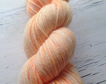 Hand Dyed Yarn Orange Creamsicle pale orsnge semisolid tonal ready to ship worsted weight yarn