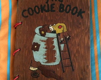 Vintage wood-cover cookie cookbook by Nellie Watts