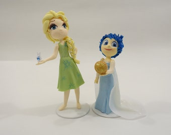 Elsa dressed as Joy and Joy Dressed as Elsa Cake Topper