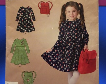 Simplcity So Easy Child's Dress Pattern with multiple sizes including a pre-cut garment