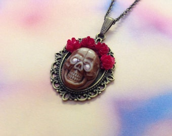 Necklace pendant skull eyes of diamonds, wreath of red roses flowers