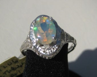 Ethiopian Opal (8x6mm) Faceted Gemstone Sterling Silver Ring, Size 7.5, No. 1206