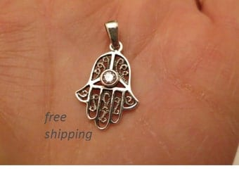 Hand of fatima, hamsa pendant in sterling silver.
