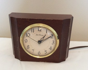 Seth Thomas electric alarm clock, Thomaston Conn. Solid mahogany, Sherwood-E