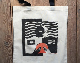 "Linocut hand printed on a Tote Bag, ""One"" 2016, with Screen Printed Detail."
