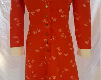 1970's Orange with white floral pattern polyester with white cuffs and collar and gold buttons