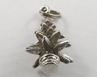 A Sterling Silver Charm of an Evergreen Tree.