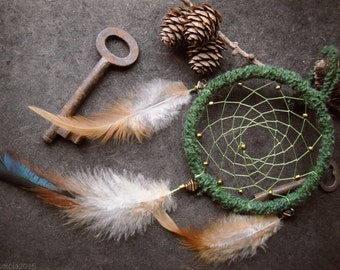 Green dreamcatcher with golden beads and rufous feathers