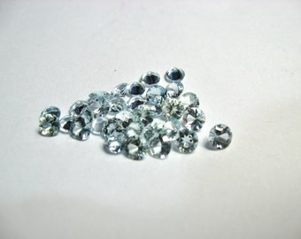 Aquamarine 4.5  mm rounds very light blue.  Choose how many you want.  More you buy better the price.