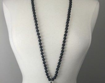 Hand knotted black Onyx beaded necklace with a soldered crystal pandant