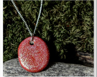 Sparkly red pendant on a silver plated chain