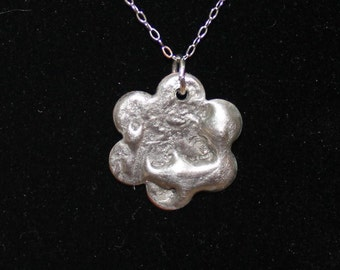 Stamped Flower Pendant