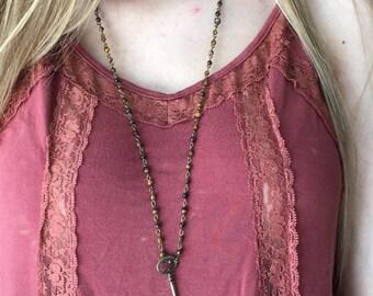 Key on brown beaded chain