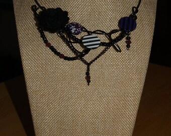Violet necklace, black wire, button