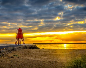 Panoramic colour photograph of the Herd Groyne Lighthouse