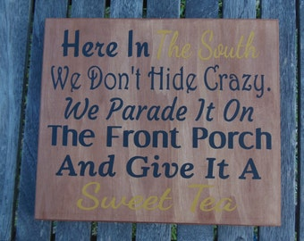 Here in the south sign Hand Painted We dont hide crazy We parade It on the front porch and give it a Sweet Tea Sign