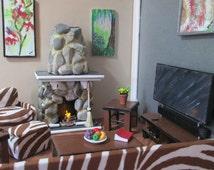 Dollhouse Seven piece living room set, entertainment center, zebra couch, zebra chair, zebra ottoman, coffee table, end tables,