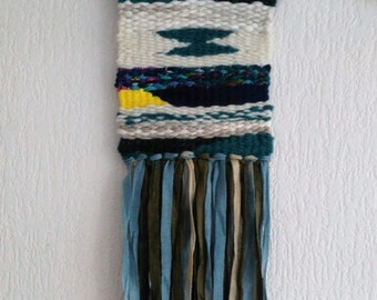 Decorative wall weaving blue, green, yellow and creamy white. Wool, fabric, cotton thread. Hand-woven