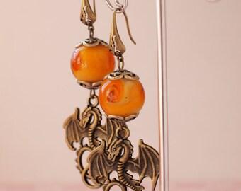 Vintage earrings orange lamp work beads with dragons