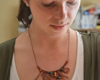Abstract copper necklace, tangled, curly, with little beads