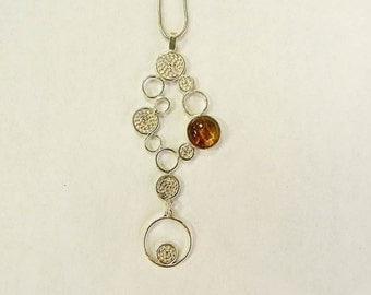 Pendant with Movement of the  Filigree DETAILS collection/ Handmade Sterling silver + Amber.