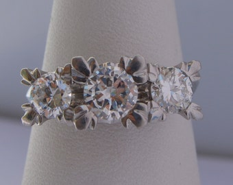 Couch from Platinum and diamonds ring 1, 70CT.  VS1 G - Platinum and Diamonds Ring 3 stone Round Brilliant VS1 G 1, 70CT.