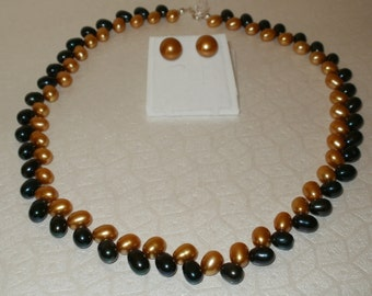 real pearl necklace  in gold and dark green pearls