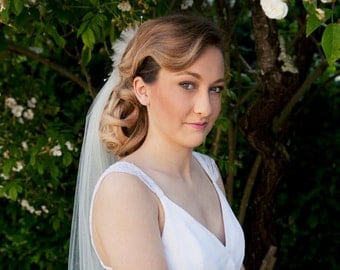 Wedding Bridal Veil in white and a  ivory hand shapped feather bouquet with little ivory pearls is attached is attached