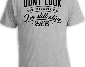 90th Birthday T Shirt 90th Birthday Gifts For Men Bday Present Don't Look So Shocked I'm Still Alive 90 Years Old Mens Ladies Tee DAT-520