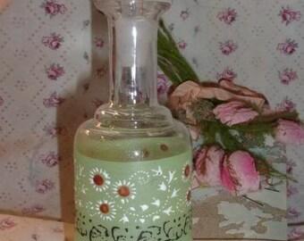 A pretty little old bottle, enameled decoration, flowers