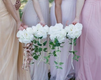 Rose, ranunculus and crystal amaranths bridesmaid bouquet