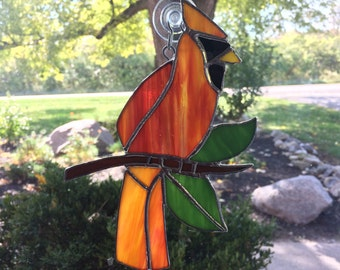 Female Cardinal in Stained Glass