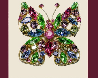 REGENCY butterfly brooch multi-color deep pink body. Signed REGENCY