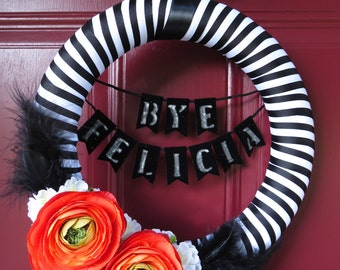 "Striped Wreath - 12 inch ""BYE FELICIA"" banner black & white striped with red/orange flowers"