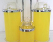 Vintage mid century lemon yellow condiment caddy with salt and pepper shakers.