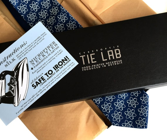 Your Necktie in Gift Box. Packaging Upgrade. Black embossed paperboard tie box, cord, tissue & care card. Perfect for silk scarves too!