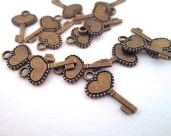 15 heart skeleton key charms, brass plated, 17x11mm, D152