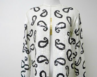 black and white . paisley . evening light jacket . fits a medium to large